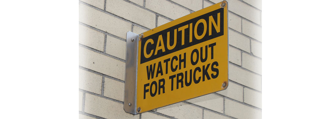 Caution watch out for trucks sign INPS