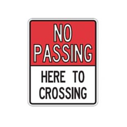 NO PASSING HERE TO CROSSING Sign