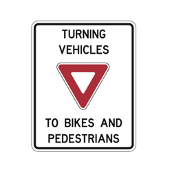 TURNING VEHICLES YIELD TO BIKES AND PEDESTRIANS Traffic Sign