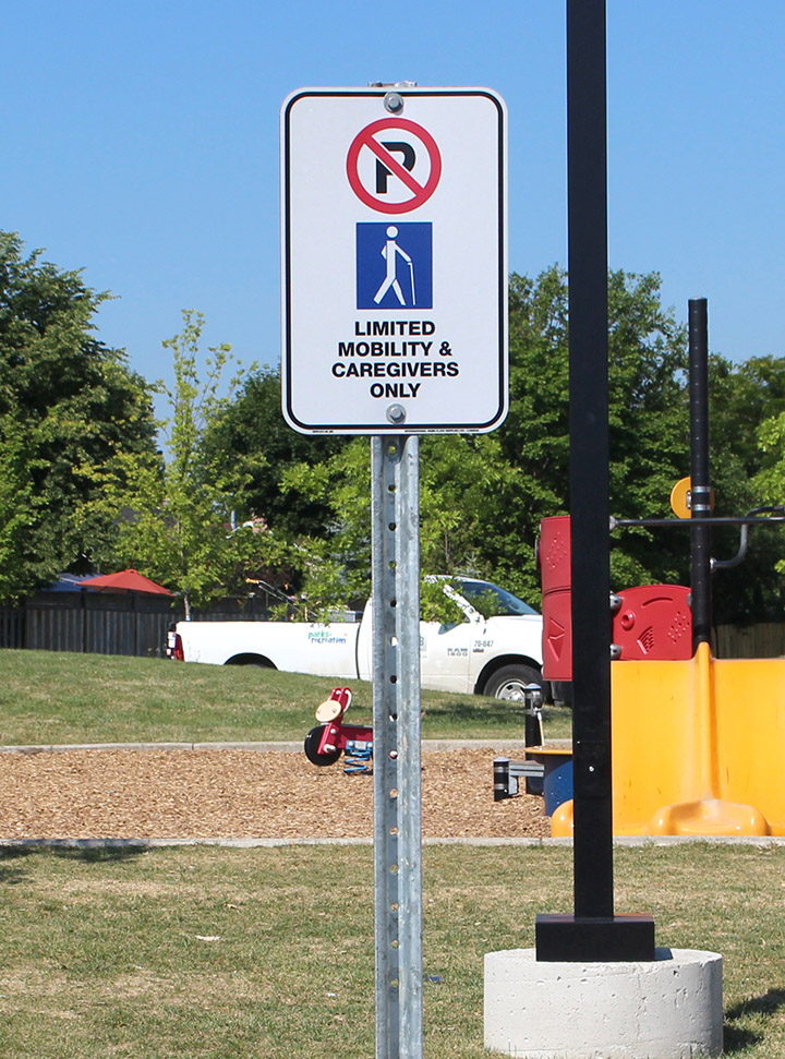 Limited Mobility & Caregivers Only Parking Sign